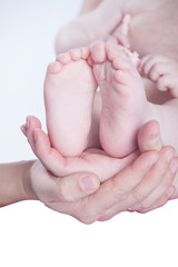 Feet in the hands of parents