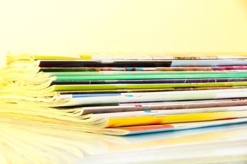 Many magazines on light background