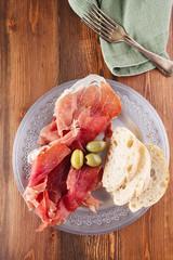 Platter of serrano jamon Cured Meat, Ciabatta, chorizo and olive