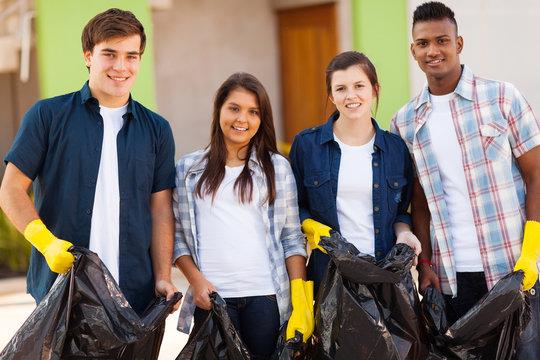 teenage volunteers with garbage bag