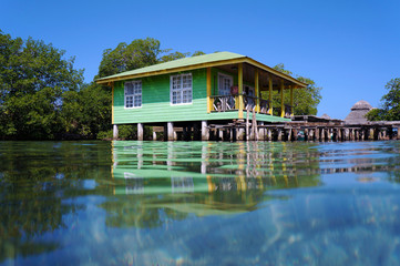 Tropical stilt house over the sea