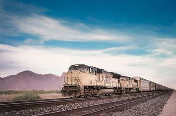 Freight train in Arizona desert landscape