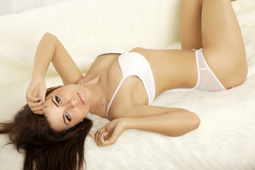 beautiful brunette in bed