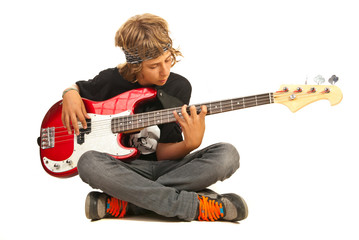 Teen boy playing bass quitar