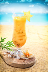 Delicious fruit cocktail on a tropical beach
