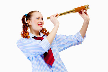 Young woman looking in telescope