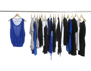 Variety of casual fashion shirt clothing on hangers and boots