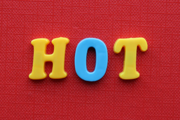 word hot on red background
