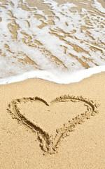 heart outline on the wet beach sand against sea wave