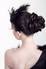 Portrait of young beautiful woman with creative elegant hairstyl
