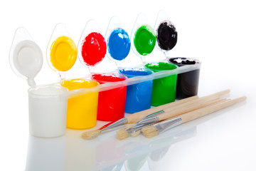 Water based paints and brush, isolated on a white background