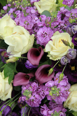 Purple and white bridal arrangement