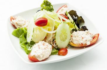Crab meat salad and mixed green.