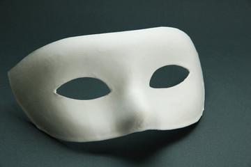 White mask, on grey background
