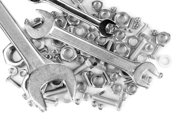 Wrenches on bolts, screws and nuts isolated on white
