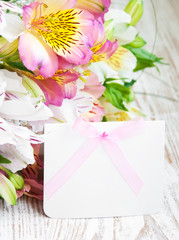 alstroemeria flowers with a white card