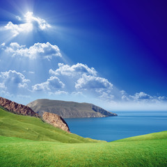 Green hills, blue sea and sky