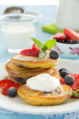 Pancakes with blueberries and strawberries.