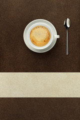 cup of coffee on the table with spoon