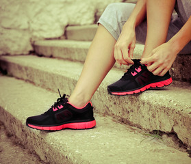 Woman trying running shoes getting ready for jogging