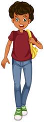 A boy walking with a bag