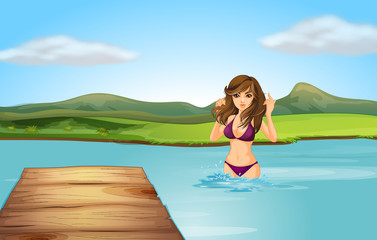 A girl at the beach with a wooden diving board