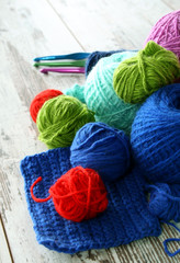 colorful balls of wool on wooden background