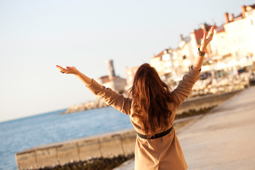 Happy Woman With Raised Hands