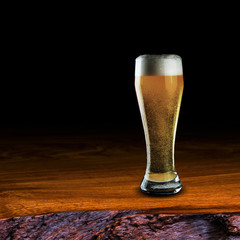 Glass of beer on wood table