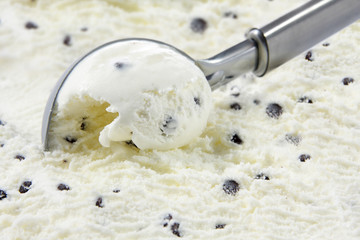 Stracciatella ice cream scooped out of container
