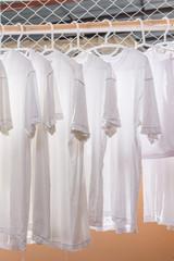White T-shirt hangers in row