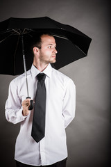 business man with an umbrella in hand