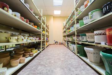 Room with shelves full of ceramic flowerpot