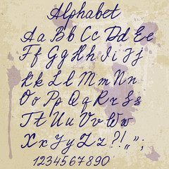 hand-written alphabet on old paper with blots
