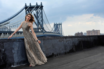 Fashion model on rooftop location with bridge on background