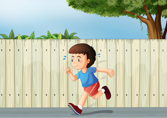 A little boy running at the road
