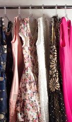 Color fashionable clothes in cloak-room