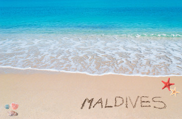 """turquoise foreshore with """"maldives"""" written on it"""