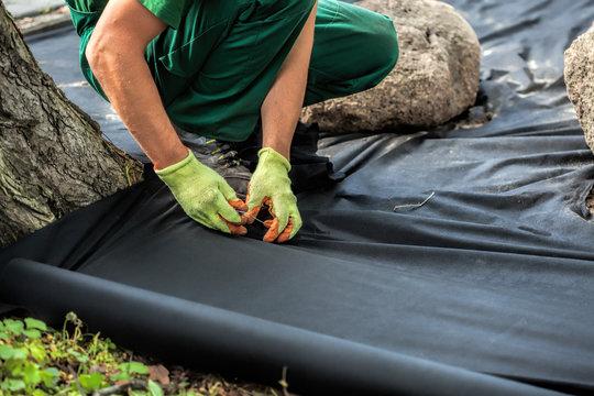Weed barrier sheet installation