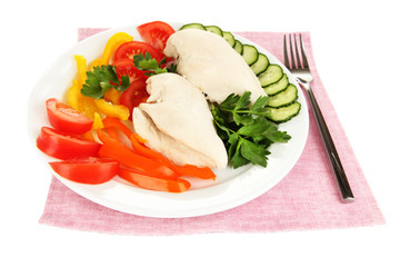 Boiled chicken breast on plate with vegetables isolated on