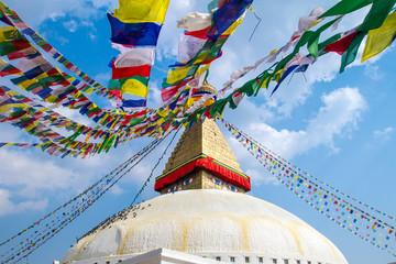 Buddhist shrine Boudhanath Stupa with Buddha wisdom eyes and pra