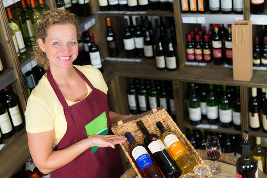 salesclerk presenting bottles of wine