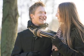 happy young caucasian couple walking