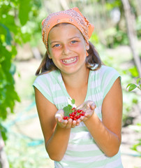 Girl holding red currant