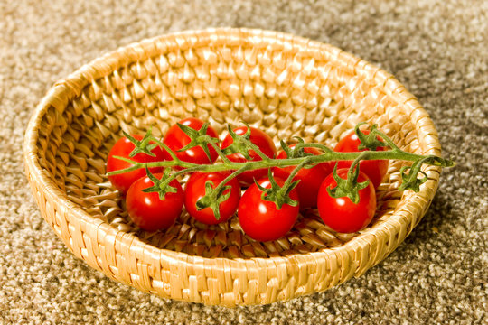beautiful tomatos in a wooden basket