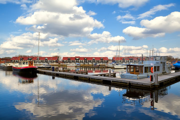 Fototapete - harbor at Reitdiephaven with sky reflected in water