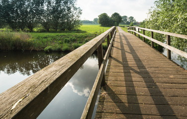 Weathered wooden bridge on a sunny day