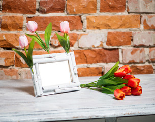 photo frame with bouquet of tulips