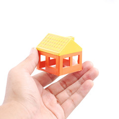 Hand holding house model