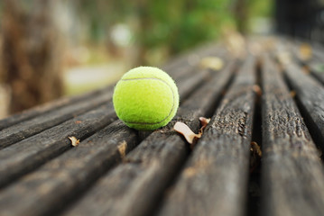 Tennis ball on wood floor